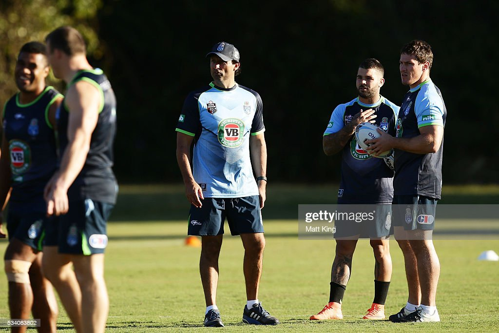Blues head coach Laurey Daley (L) talks to trainer <a gi-track='captionPersonalityLinkClicked' href=/galleries/search?phrase=Adam+Reynolds+-+Rugby+Player&family=editorial&specificpeople=12886494 ng-click='$event.stopPropagation()'>Adam Reynolds</a> (C) and <a gi-track='captionPersonalityLinkClicked' href=/galleries/search?phrase=Josh+Jackson+-+Rugby+League+Player&family=editorial&specificpeople=241393 ng-click='$event.stopPropagation()'>Josh Jackson</a> (R) of the Blues during a New South Wales Blues State of Origin training session on May 25, 2016 in Coffs Harbour, Australia.