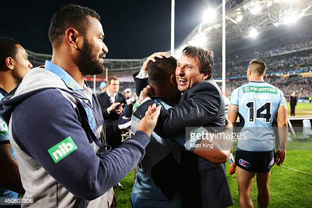 Blues head coach Laurie Daley celebrates with Blues players during game two of the State of Origin series between the New South Wales Blues and the...