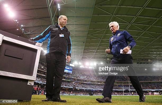 Blues head coach Michael Malthouse is shown the door by a security guard at the start of the third quarter during the round eight AFL match between...