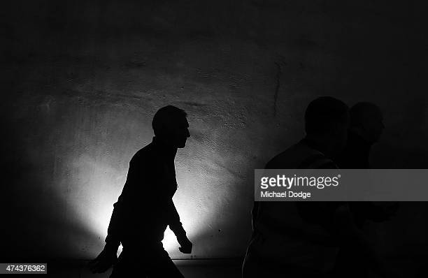 Blues head coach Michael Malthouse walks out during the round eight AFL match between the Geelong Cats and the Carlton Blues at Etihad Stadium on May...