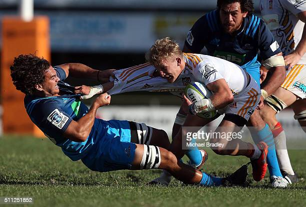 Blues Kara Pryor tackles Chiefs Damian McKenzie during the Super Rugby preseason match between the Blues and the Chiefs at Pukekohe Stadium on...