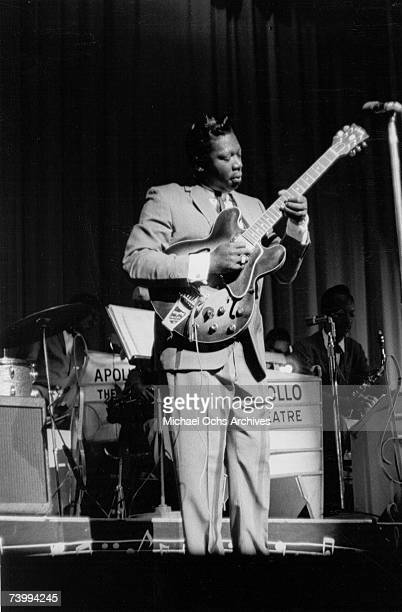 Blues musician BB King performs onstage with his Gibson hollowbody electric guitar nicknamed 'Lucille' in 1963 at the Apollo Theater in Harlem New...