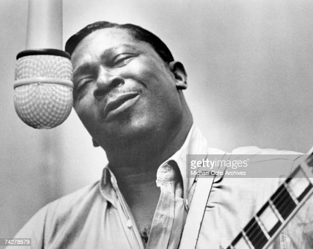 Blues musician BB King records in the studio with his 'Lucille' model Gibson hollowbody electric guitar in circa 1965