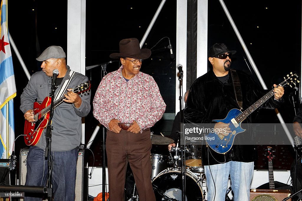 Blues musician Lonnie Brooks(c), performs with his sons Ronnie Brooks and Wayne Baker Brooks during a celebration honoring blues musician Buddy Guy's Kennedy Center Honor at the Pritzker Pavilion in Chicago, Illinois on NOVEMBER