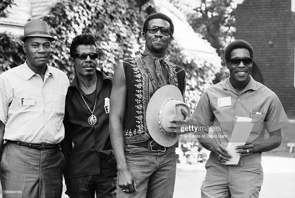 Blues musician Taj Mahal (2nd from right)) poses for a portrait with blues guitarist and singer <a gi-track='captionPersonalityLinkClicked' href=/galleries/search?phrase=Buddy+Guy&family=editorial&specificpeople=215438 ng-click='$event.stopPropagation()'>Buddy Guy</a> (far right) and sax player A.C. Reed (left) in July, 1968 at the Newport Folk Festival in Newport, Rhode Island.