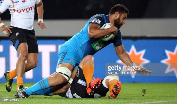 Blues' Patrick Tuipulotu reaches out for a try during the Super Rugby match between New Zealand's Blues and South Africa's Cheetahs at Eden Park in...