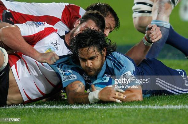 Blues Piri Weepu is tackled during the round 12 Super Rugby match between the Blues and the Lions at Eden Park on May 11 2012 in Auckland New Zealand