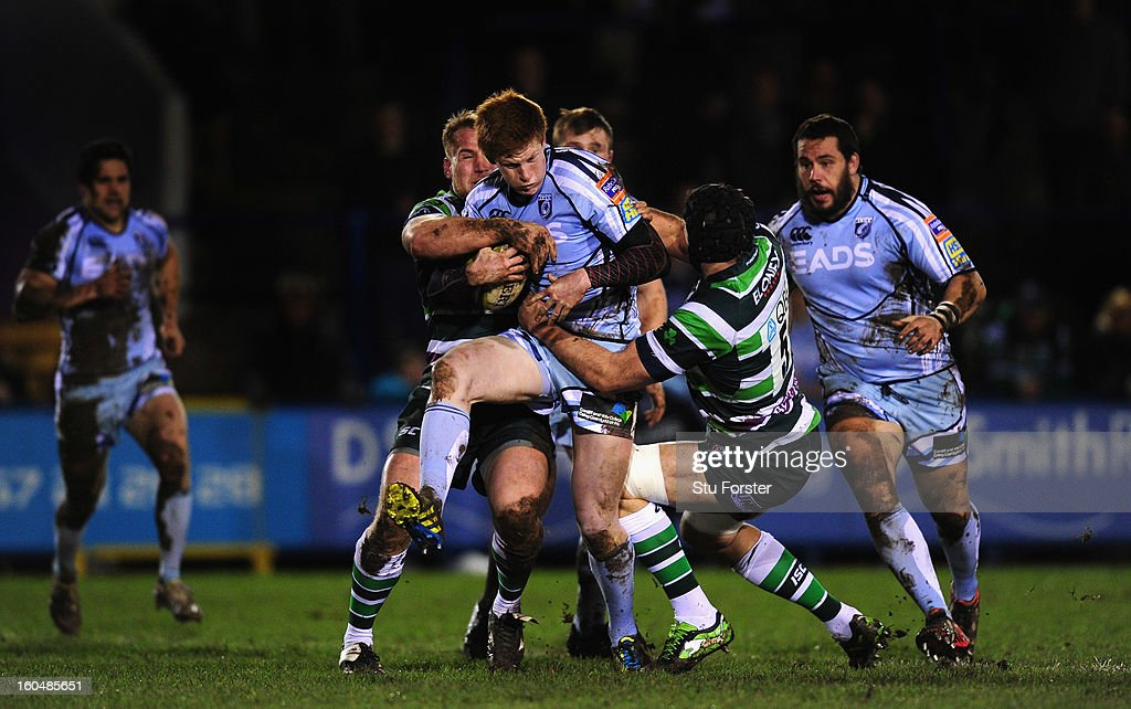 Blues player Rhys Patchell is wrapped up by Mike Mayhew (l) and Bryn Evans of London Irish during the LV= Cup match between Cardiff Blues and London Irish at the Arms Park on February 1, 2013 in Cardiff, Wales.