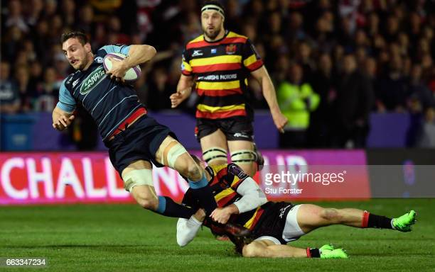 Blues player Sam Warburton is tackled by Jonny May of Gloucester during the European Rugby Challenge Cup match between Gloucester Rugby and Cardiff...