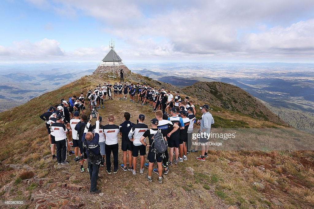 Blues players and coaches form a huddle on the summit of Mount Buller during the Carlton Blues AFL training camp on January 28, 2015 in Mount Buller, Australia.