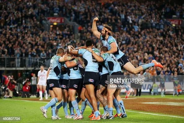 Blues players celebrate a try by Trent Hodkinson during game two of the State of Origin series between the New South Wales Blues and the Queensland...