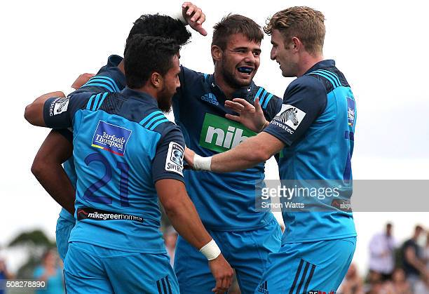 Blues players celebrate a try during the Super Rugby preseason match between the Blues and the Rebels at Pakuranga Rugby Club on February 4 2016 in...