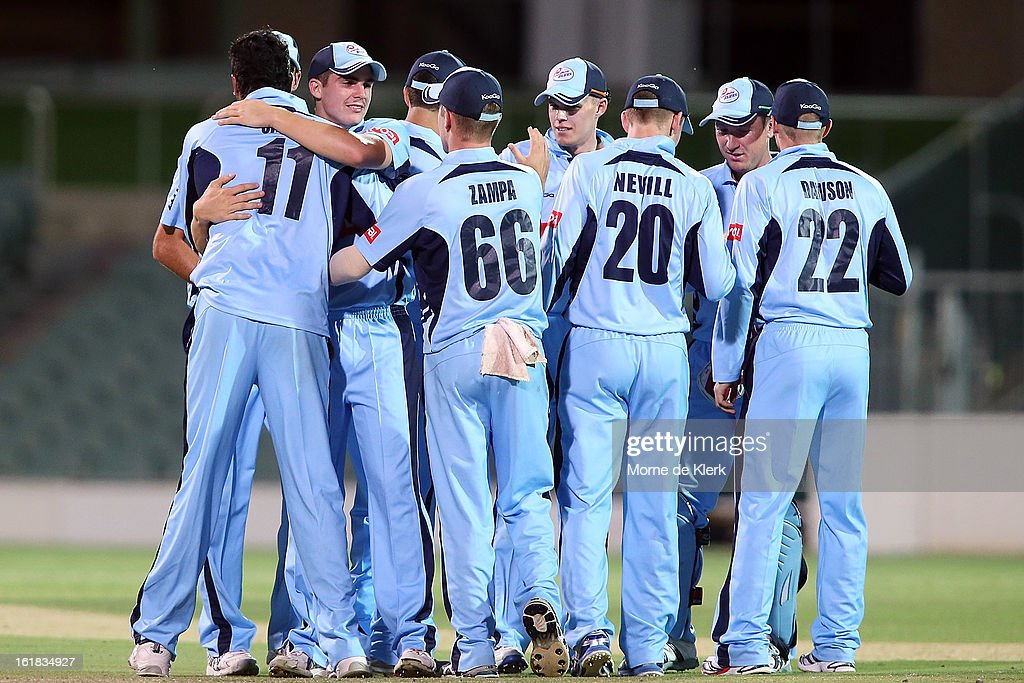 Blues players celebrate after the Ryobi One Day Cup match between the South Australian Redbacks and the New South Wales Blues at Adelaide Oval on February 17, 2013 in Adelaide, Australia.