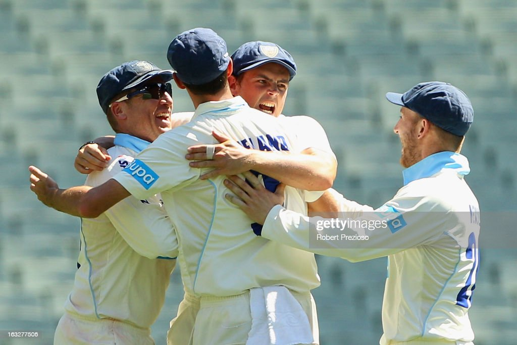 Blues players celebrate the wicket of John Hastings of the Bushrangers off the bowling of Gurinder Sandhu of the Blues during day one of the Sheffield Shield match between the Victorian Bushrangers and the New South Wales Blues at Melbourne Cricket Ground on March 7, 2013 in Melbourne, Australia.