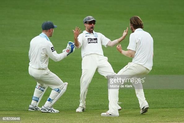 Blues players celebrate with teammate Ed Cowan after he runout Sam Raphael of the SA Redbacks with a direct hit during day three of the Sheffield...