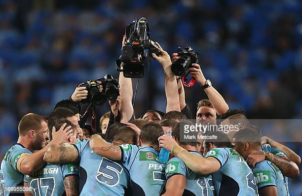 Blues players form a huddle after victory during game one of the ARL State of Origin series between the New South Wales Blues and the Queensland...