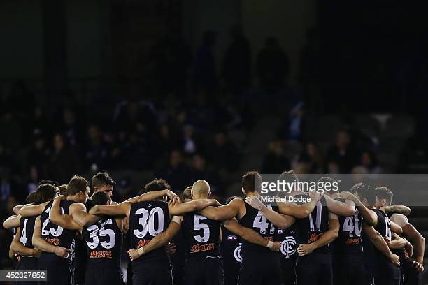 Blues players form a huddle at half time during the round 18 AFL match between the Carlton Blues and the North Melbourne Kangaroos at Etihad Stadium...