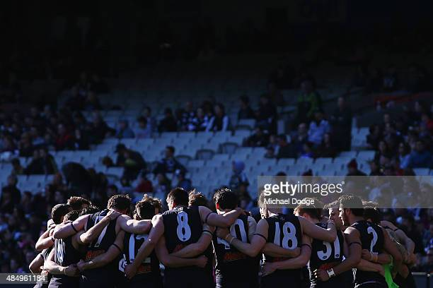 Blues players form a huddle before the round 21 AFL match between the Carlton Blues and the Melbourne Demons at Melbourne Cricket Ground on August 23...