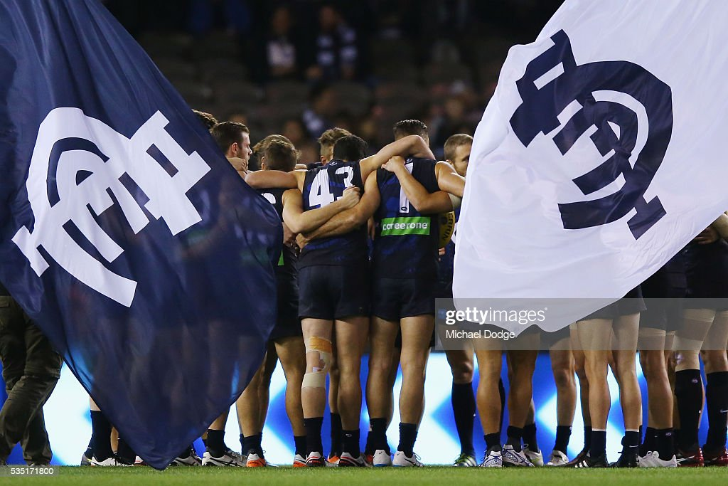 Blues players form a huddle during the round 10 AFL match between the Carlton Blues and the Geelong Cats at Etihad Stadium on May 29, 2016 in Melbourne, Australia.