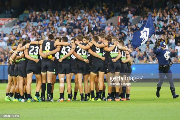 Blues players form a huddle during the round one AFL match between the Carlton Blues and the Richmond Tigers at Melbourne Cricket Ground on March 23...