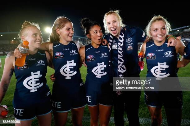 Blues players gather to sing the team song during the 2017 AFLW Round 01 match between the Carlton Blues and the Collingwood Magpies at Ikon Park on...