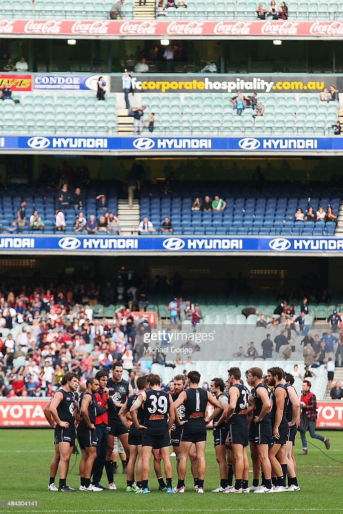 Blues players huddle after their defeat during the round four AFL match between the Carlton Blues and the Melbourne Demons at Melbourne Cricket Ground on April 12, 2014 in Melbourne, Australia.