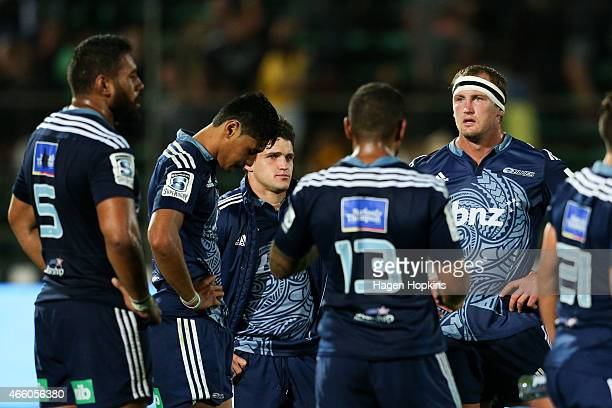 Blues players look on in disappointment after the final whistle of the round five Super Rugby match between the Hurricanes and the Blues at Arena...