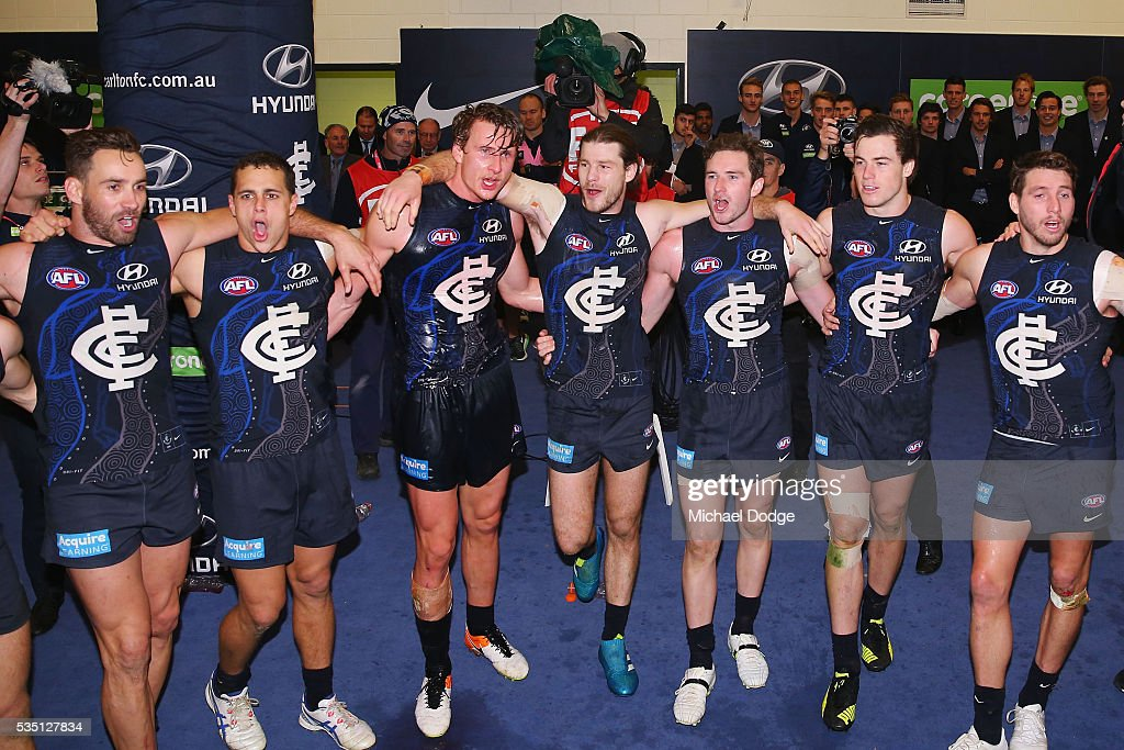 Blues players sing the club song after winning during the round 10 AFL match between the Carlton Blues and the Geelong Cats at Etihad Stadium on May 29, 2016 in Melbourne, Australia.