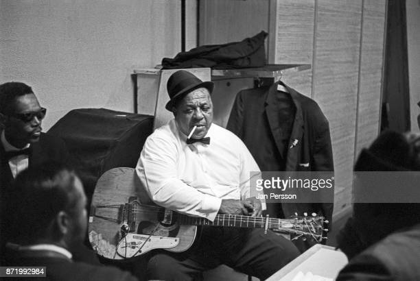 Blues singer and guitarist Big Joe Williams backstage with friends at Tivoli Gardens Concert hall Copenhagen Denmark 1968