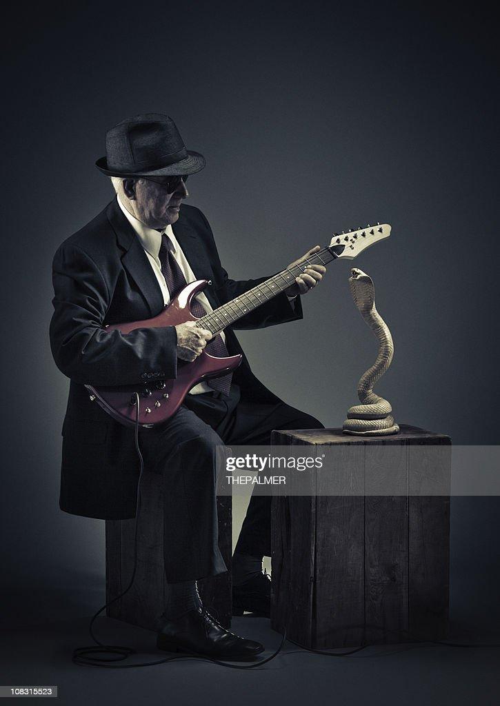 blues snake charmer : Stock Photo