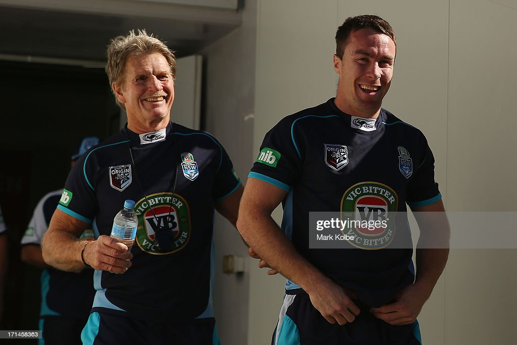 Blues trainer Ronnie Palmer and James Maloney share a laugh as they walk onto the field during a New South Wales Blues State of Origin training session at Suncorp Stadium on June 25, 2013 in Brisbane, Australia.