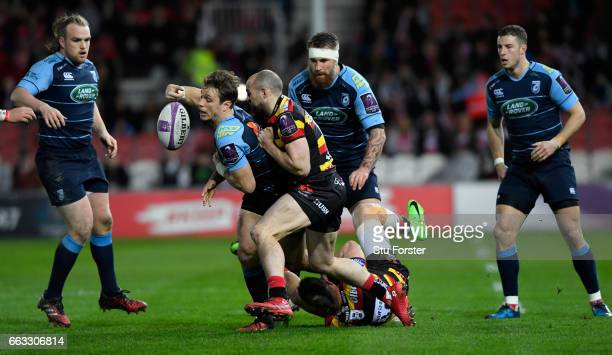 Blues wing Blaine Scully knocks the ball on under the challenge from Charlie Sharples of Gloucester during the European Rugby Challenge Cup match...