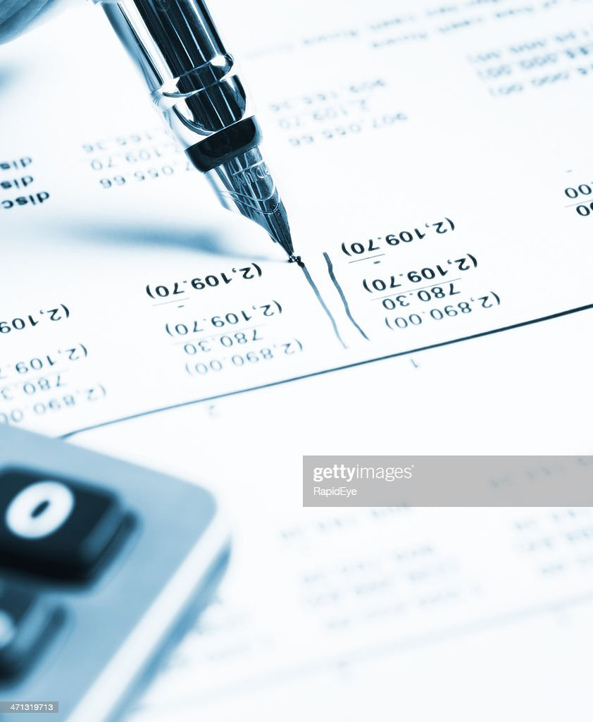Blue-tinted image of pen, spreadsheet and calculator checking financial statement