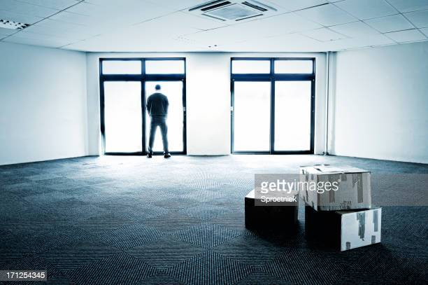 Blue-toned empty office showing business failure