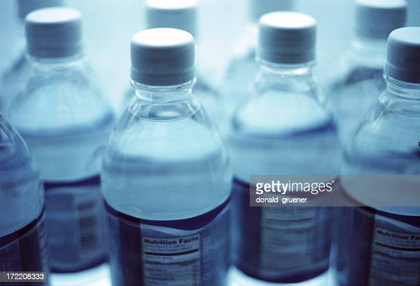 Blue-toned image of plastic bottles of water