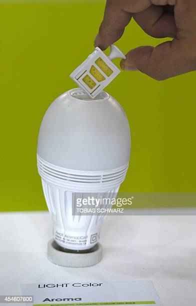 A bluetooth aromatic color led bulb is presented at the French Smart Home design company AwoX booth during the second press day of the consumer...