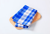 blue-white dish towel on a cutting board