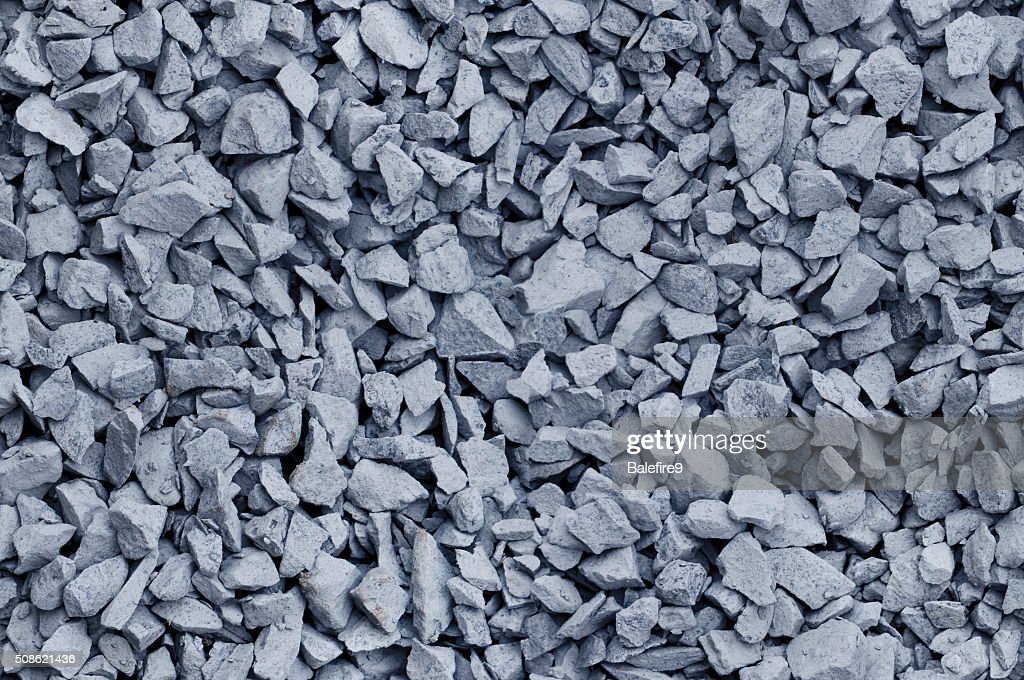 Bluish Gray gravel used for construction fill - seamless background : Stock Photo