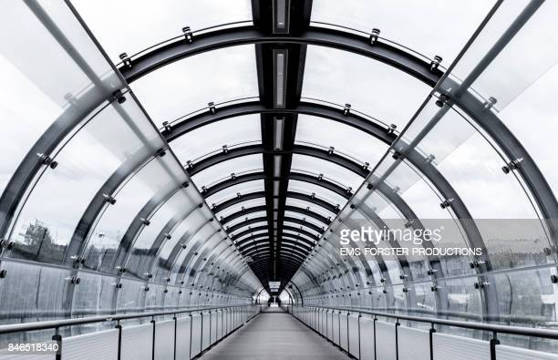 bluish tunnel tube view and modern architecture