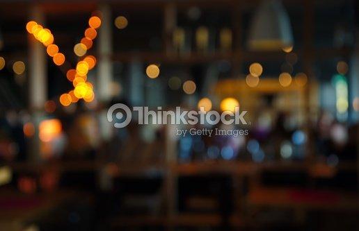 blur dark bar or cafe at night : Stock Photo