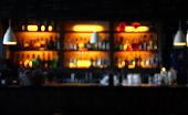 blur hanging lamp on bar counter  at night