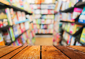blur image of   book store on shelf at shopping center forbackground usage.