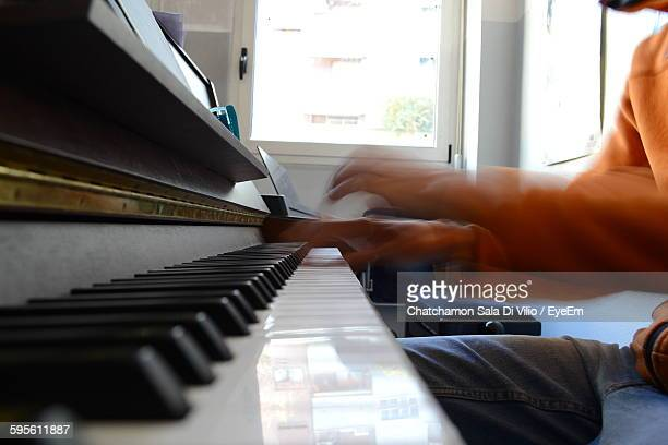 Blur Image Of Musician Playing Piano In Recording Studio