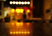 blur light reflection on table in bar at night background