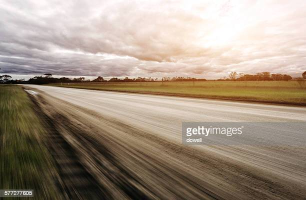 Blur motion road with cloud sky