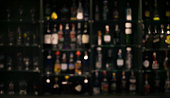 blur of bottles counter bar Background in dark