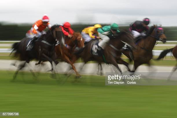 A blur of movement and motion as the horses head down the finish straight during a day at the Races at the Gore Race Meeting Gore Southland New...