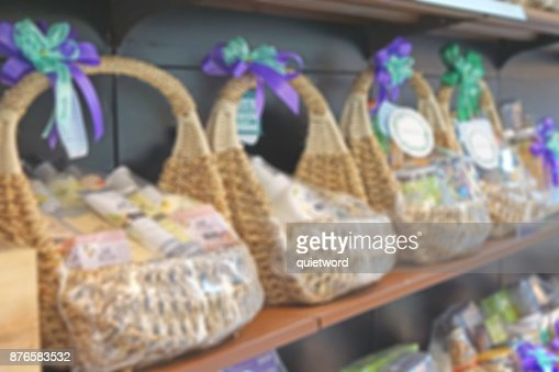 blur photo of wicker basket full with gift pack ready for sale at shelf : Stock Photo