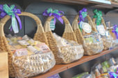 blur photo of wicker basket full with gift pack ready for sale at shelf