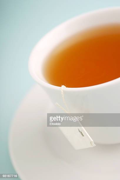 Blur white cup of tea in a light blue background